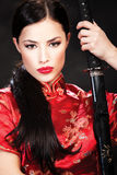 Woman with sword. Portrait of woman with sword Stock Image