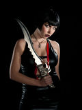 Woman with sword. Attractive woman wearing black with sword Royalty Free Stock Photos