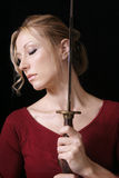 Woman with sword stock images