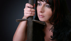 Woman With Sword. Woman warrior with an old sword Stock Photos