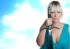 Woman with sword and cross Stock Images