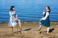 Woman with sword and man in scottish costume Royalty Free Stock Photo