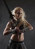Woman and sword Stock Image