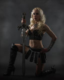Woman and sword Stock Photos