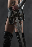 Woman and sword Stock Photo