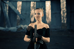 Woman with sword portrait Stock Photography