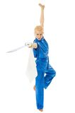 Woman with sword practice of martial arts. Woman in blue kimono with metal sword making training exercises practice of martial arts Stock Photography