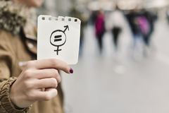 Woman with a symbol for gender equality royalty free stock images