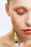 Woman with syringe Royalty Free Stock Images
