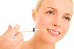 Woman with syringe of Botox Stock Image