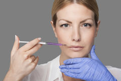 Woman with syringe Stock Photography