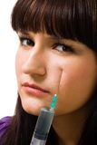 Woman with syringe treat problem with skin Stock Photography