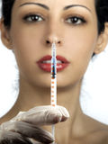 Woman with syringe Stock Image
