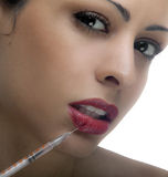Woman with syringe Royalty Free Stock Photos