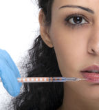 Woman with syringe Stock Images
