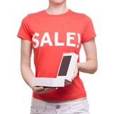 Woman with t-shirt with an inscription sale in hand smartphone mobile phone shop buy discount. On a white background isolation Royalty Free Stock Photography