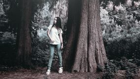 Woman in T Shirt Posing Beside Rough Bark Tall Tree in Grayscale Photography Royalty Free Stock Photography