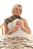Woman table change hold bills Royalty Free Stock Photography