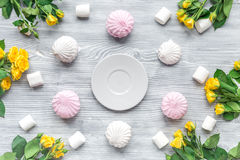 Woman table design with flowers and marsh-mallow soft light top view pattern. Woman table trendy design with yellow flowers and marsh-mallow in soft light on Stock Image