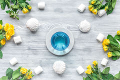Woman table design with flowers and marsh-mallow soft light top view pattern. Woman table trendy design with yellow flowers and marsh-mallow in soft light on Royalty Free Stock Images
