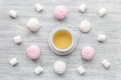 Woman table design with tea and marsh-mallow soft light top view pattern Royalty Free Stock Photos