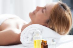 Woman on a table massage. Portrait of a woman on table massage with essentials oils Stock Image