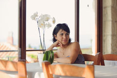 Woman at Table Royalty Free Stock Photography