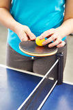 Woman with table tennis racquet Stock Images