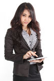 Woman and tablet. Businesswoman touch her tablet on left hand at office Royalty Free Stock Photo
