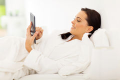Woman tablet bed Stock Photography