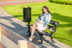 Woman with tablet on bench at park Royalty Free Stock Images