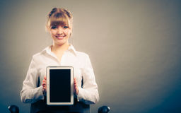 Woman with tablet. Blank screen copy space. Stock Image