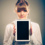 Woman with tablet. Blank screen copy space. Royalty Free Stock Image