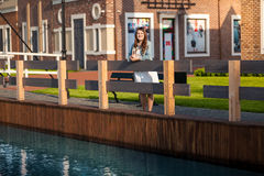 Woman with tablet on bridge at Amsterdam Stock Photography