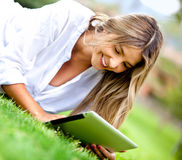 Woman with a tablet computer Stock Image