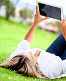 Woman with a tablet computer Stock Photography
