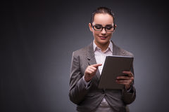 The woman with tablet computer in business concept Stock Image