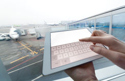 Woman with tablet computer empty screen at airport Stock Photos