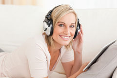 Woman with a tablet computer and headphones Royalty Free Stock Photo