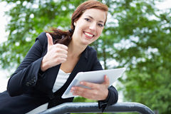 Woman with tablet computer holding Stock Photos