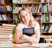 Woman with tablet computer in library Stock Photos
