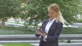 Woman with tablet computer near office building. close up