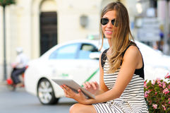 Woman with tablet computer in urban background Stock Photography