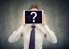 Woman with tablet covering face royalty free stock images