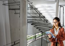 Woman with tablet  designing the office stair with lines where it going to be. Digital composite of woman with tablet  designing the office stair with lines Stock Photos
