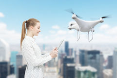 Woman with a tablet, drone, city Stock Image