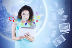 Woman with tablet and earth Royalty Free Stock Photos