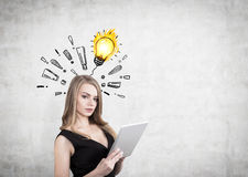 Woman with tablet and exclamations, bulb Stock Images