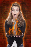 Woman with tablet on fire Stock Photo