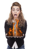 Woman with tablet on fire Stock Photography